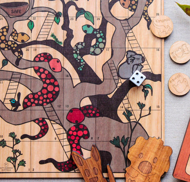 An Australian made wooden snakes and ladders game featuring Australian animals made by Buttonworks