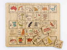 Load image into Gallery viewer, A wooden Australian alphabet puzzle featuring Australian animals and Australian icons on each of the alphabet pieces made by Buttonworks Australia