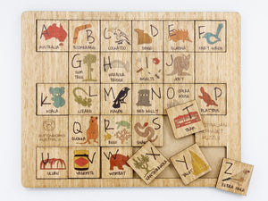 A wooden Australian alphabet puzzle featuring Australian animals and Australian icons on each of the alphabet pieces made by Buttonworks Australia