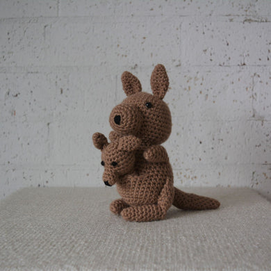 Handmade Crochet Australian Animal of a brown kangaroo and a joey in it's pouch with a black nose and black eyes