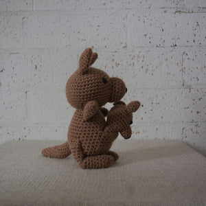 Handmade Crochet Australian Animal of a brown kangaroo and a joey in it's pouch with a black nose and black eyes. This is the side view.