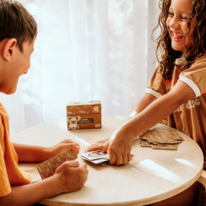 Modern Monty. Children playing the Modern Monty Snap and Go Fish card game with Australian animals sold by Gumnut Kids.