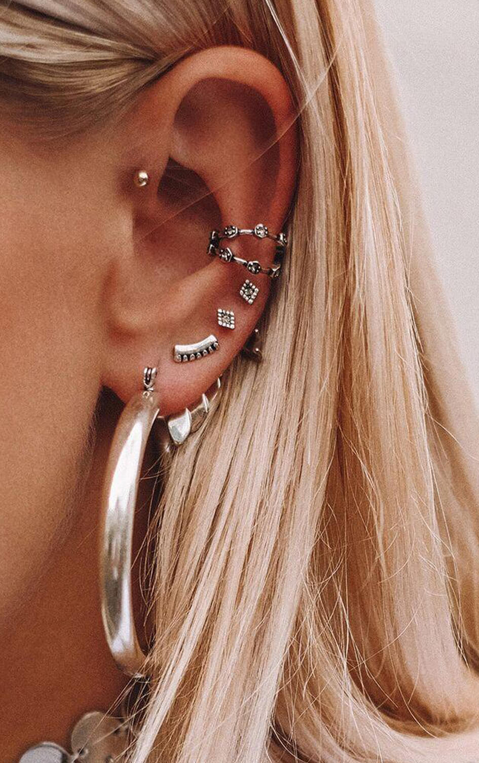 luv-aj-silver-amalfi-tube-hoop-earrings-on-model