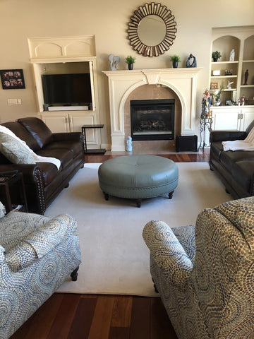 white contemporary area rug with ottoman and couches
