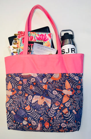 pink inrugco tote carrying books and water bottle