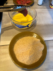 making the breading for a steak sandwich