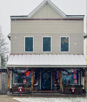 InRugCo Studio & Gift Shop storefront with snow falling