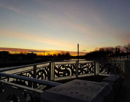 Mishawaka Indiana Beutter Park Sunset over suspension bridge