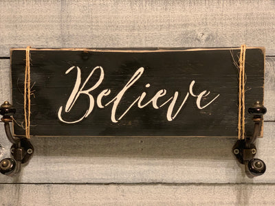 Believe farmhouse sign is made from reclaimed wood in dark charcoal color
