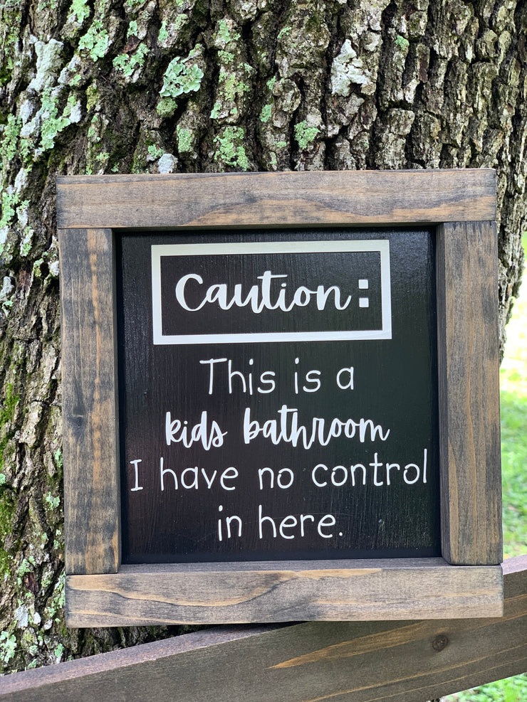 Caution:  This is a kids bathroom, is a funny sign you can add to any bathroom decor.  This sign is available in two version, black background with white lettering, or white background with black lettering.