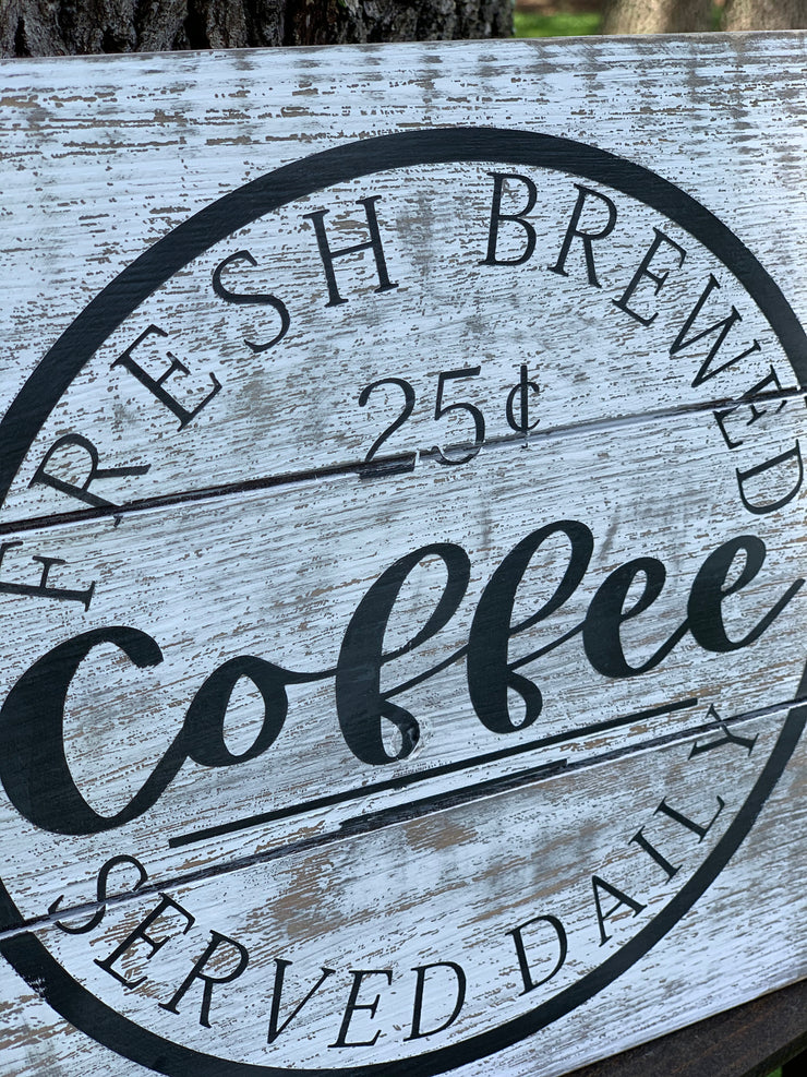 This image shows a close of view of the hand painted sign and white distressed pallet board.