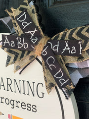 This picture shows a close up of the burlap bow and alphabet ribbon used.