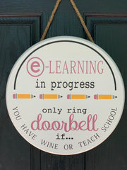 "E-Learning Door Hanger is shown in the 15"" round sign with a twine rope to hang.  The wording for e-learning and doorbell are painted in a mauve.  The pencils are painted to look like an actual pencil.  This sign can be completely customized to fit your needs.  We will try to color match as best as we can.  All sales are final.  No returns accepted."