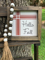 "Hello Fall 7x7 sign is shown sitting outside on a ladder.  It is paired with our 25"" beaded garland.  Each item sold separately."
