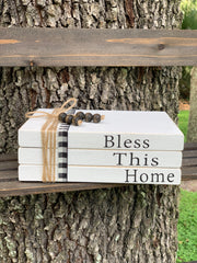This image shows the white large book set that says bless this home.