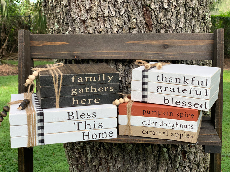 This image shows the set of 4 wooden books (family gathers here), (bless this home), (thankful, grateful, blessed), and (our pumpkin set).  Each set sold separately.