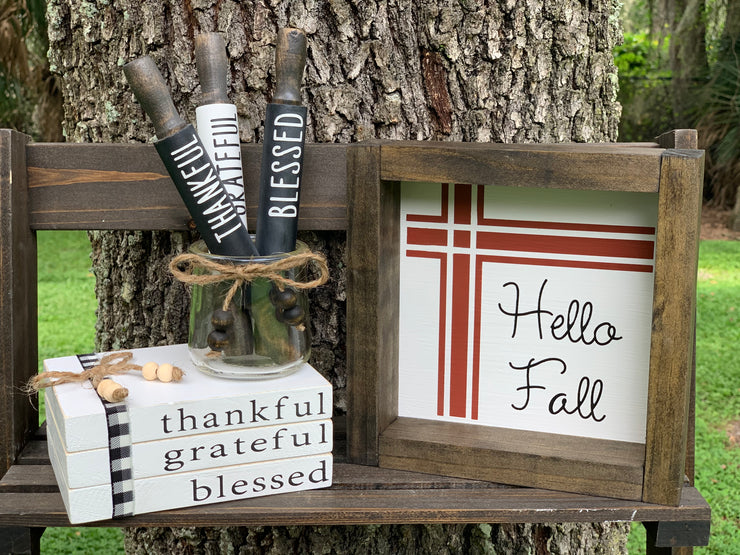 This image shows the hello fall sign paired with our thankful, grateful, and blessed wooden books and our mini rolling pins.  Each item sold separately.