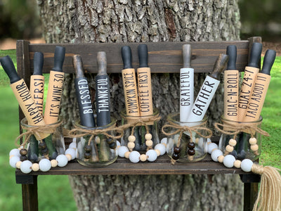 Mini Rolling Pins image shows 12 different saying to choose from or make your own customized version.  Choose from natural with black writing, black with white writing, or white with black writing.  Each pin is sold separately.