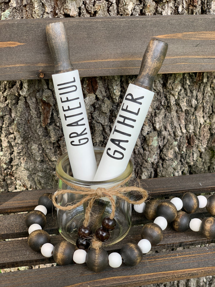 This image shows the white painted gather and grateful mini rolling pins. Each pin is sold separately.