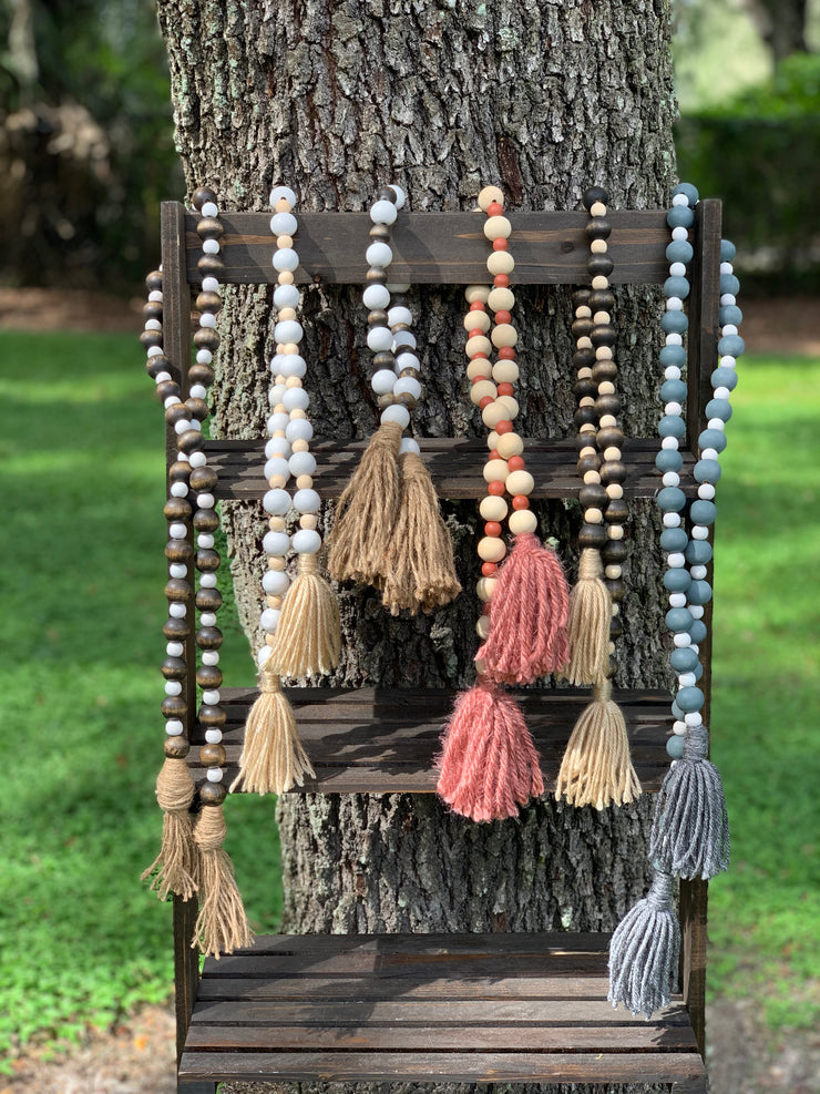 This image shows all the wooden beaded garland in a variety of colors to choose from.  Each garland is sold separately.