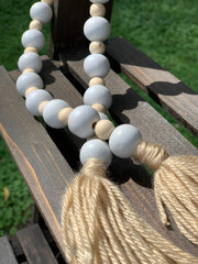 This image shows a close up of the beads and the yarn tassels.