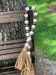 "This image shows the 25"" large white beads and small Jacobean stained beaded garland.  This measures 25"" from tassel to tassel. It has a twine tassel at both ends."