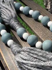 This image shows a close up of the beads and yarn tassels.