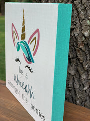 This image is showing the turquoise trim around the sign.