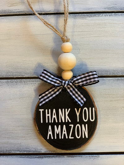 Thank You Amazon Christmas Ornament is shown with a buffalo plaid ribbon and 3 wooden beads.  Ribbon will vary due to demand.