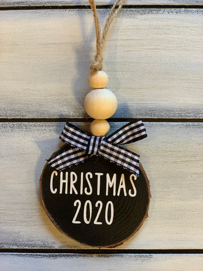 Christmas 2020 Christmas Ornament is shown with a buffalo plaid ribbon and 3 wooden beads.  The ribbon will vary due to demand.