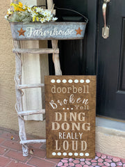 Doorbell Broken, Yell Ding Dong Really Loud - alternate image 1 - shows the sign at a front door sitting on the ground leaning against a ladder with the Vintage Galvanized Metal Hanging Basket holding flowers.  Sign and hanging basket each sold separately.