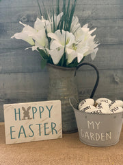 Happy Easter Small Wood Block Sign is paired with a galvanized metal pitcher with a floral arrangement and a galvanized metal bucket with eggs.  Each sold separately.