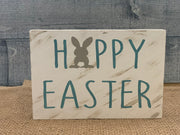 Happy Easter Small Wood Block sign is shown by itself sitting on a table.