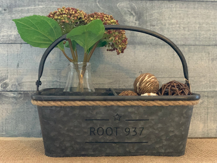 Galvanized metal Divided Organizer Basket is shown with decorative assorted round textured balls and a glass milk bottle with two flowers.  Divider not sold with accessories.