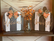 This image shows the thankful and blessed pumpkins with our bittersweet floral design.  Each item sold separately.