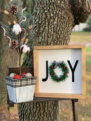 "Joy 12x12 Sign with a Wreath ""O"" shows the sign with our Mini Christmas tree in a galvanized container.  Each item sold separately."