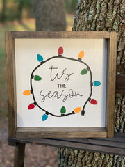 This image shows the shadowbox sign with the mulitcolored lights and the hand painted words Tis the Season.