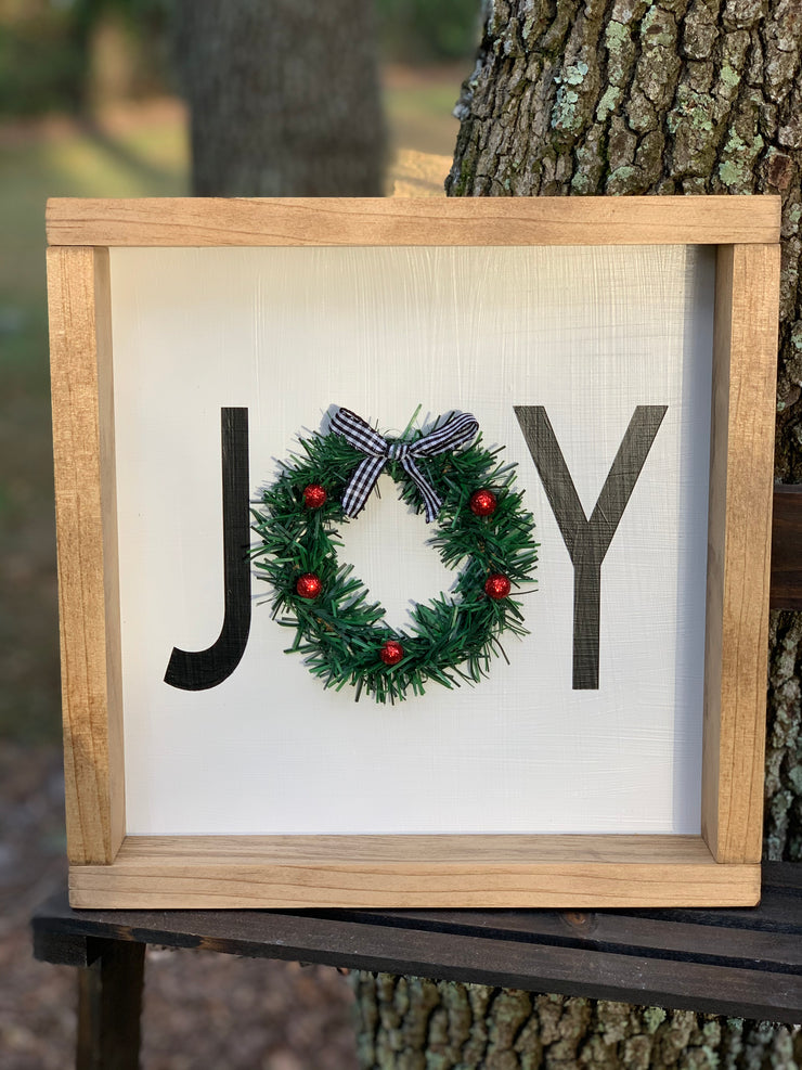 "This image shows the sign by itself, highlighting the ""O"" wreath."