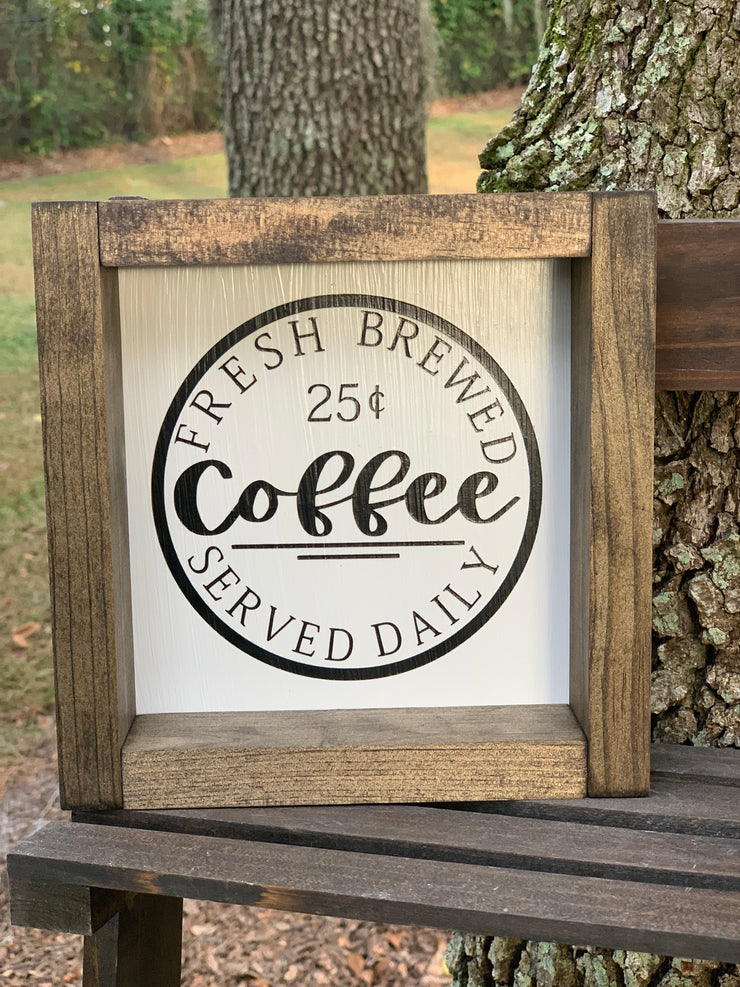 This is our 7x7 framed coffee sign.  Classic look with Jacobean stained shadowbox frame.  Sits on a shelf or hands from a wall.  Perfect for any coffee bar.