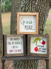 This image shows all three Grinch signs we sell.  The Grinch, Please, In a world full of Grinches, be a Cindy Lou Who, and Stink, Stank, Stunk.  All signs are sold separately.