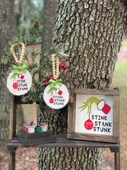 Stink, Stank, Stunk Grinch Hand 7x7 Frame is shown with our mini Christmas tree and the Grinch ornaments.  Each item is sold separately.