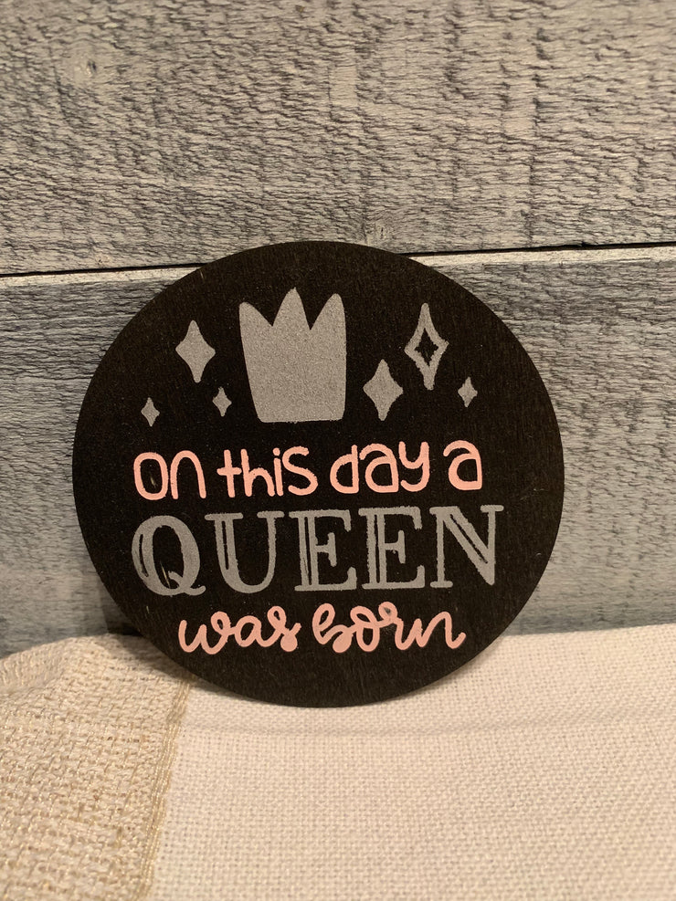 "On This Day A Queen Was Born is an image of the disc that goes with the ""Our Home"" sing."