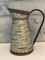 Vintage Galvanized Metal Pitcher shows an image of the pitcher sitting on a table.