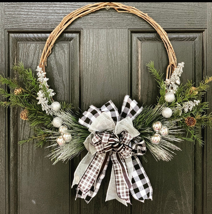 Buffalo Plaid Wood Twine Wreath is shown hanging on a door.  Makes a beautiful way to welcome all your guests for the holidays.