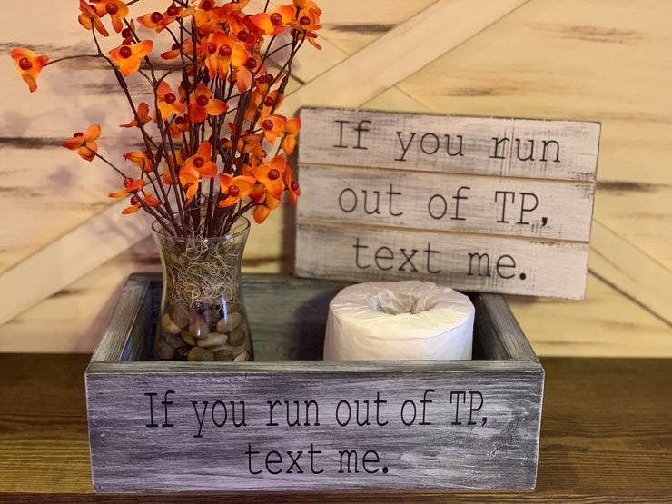 "Bathroom Box Organizer is shown with the words ""If you run out of TP, Text me"".  Each item shown is sold separately.  Item does not come with toilet paper."