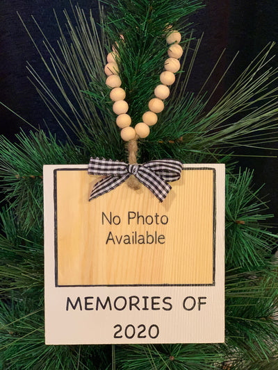 Memories of 2020 Wood Ornament is shown hanging on the Christmas tree.  Makes a great stocking stuffer, family ornament, or to add to any packages as an added embellishment.