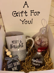 This gift set comes with your porcelain glitter mug, a hot chocolate filled ornament ball, a dark chocolate espresso bean filled ornament ball and a paired wood sliced ornamet.