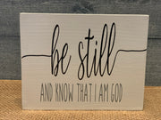 Be Still and Know That I am God shows an image of the white sign sitting on a table.
