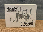 Thankful, Grateful, Blessed (Small Block Sign) shows an image of the white sign sitting on a table.