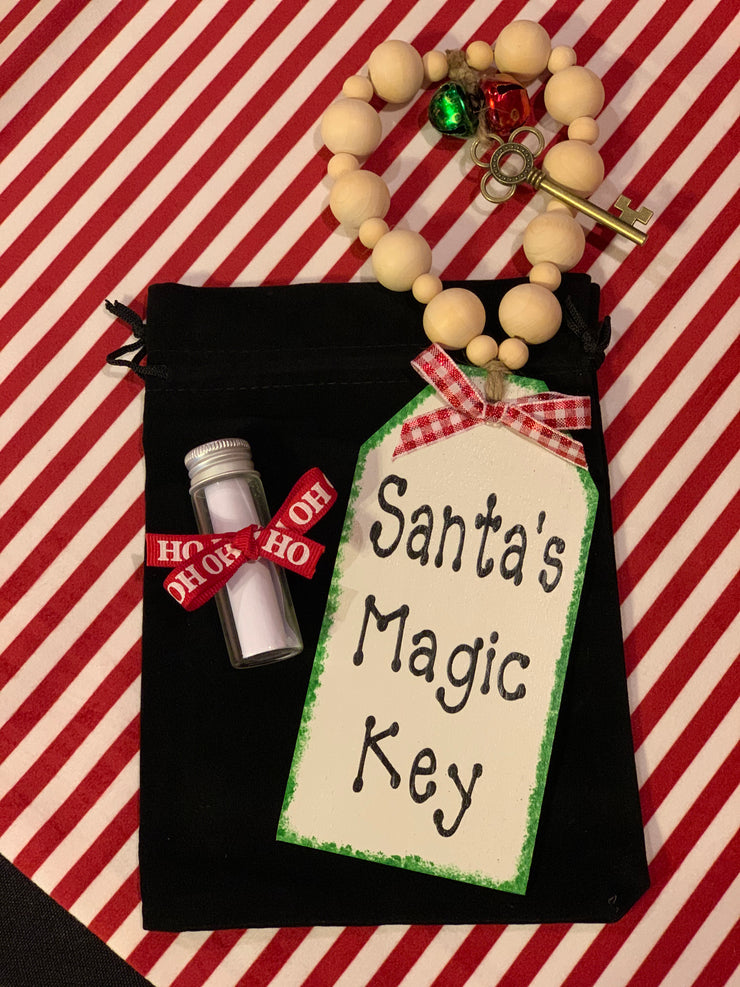 Santa's Magic Key is a special real metal skeleton key made to hang on your front door for santa to let himself in when you don't have a chimney. Comes with a special sealed note from Santa in a glass container.  Store in a velvet black drawstring bag to keep safe all year round.